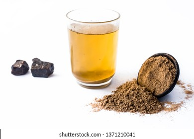 Home remedy to reduce headache or to treat headache isolated on white i.e. Hing or Devil's dung powder well mixed in water.