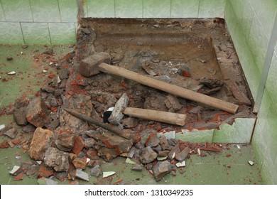 Home renovation, old bathtub and tiles demolishing in bathroom
