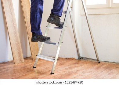 Home renovation and repairing concept with ladder on parquet floor