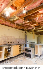 Home renovation scene with a kitchen ceiling rip out prior to a refurbishment and kitchen fitting