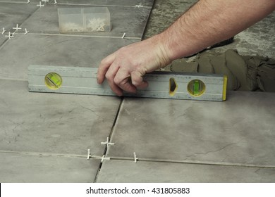 Home , renovation -  tiler is tiling