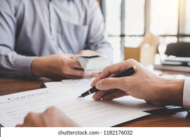 Home for rent concept, broker agent presenting and consult detail to customer to making the decision a home estate loan to customer sign form agreement, home model.