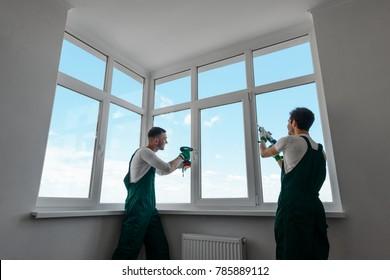 Home repair and improvement services. Handyman team is fixing a PVC window, replacing an old handle and sealing silicone.
