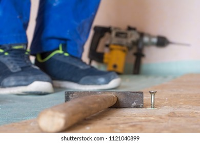 Home repairs. Worker, construction tools, nails, drill, hammer