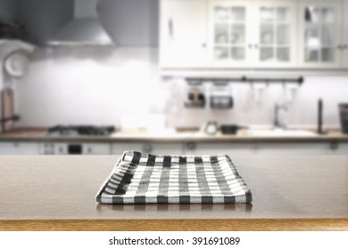 home retro interior background of kitchen in white color and blue napkin brown table and light