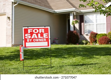 Home: For Sale By Owner Sign In Front Yard