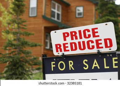 Home For Sale Price Reduced Sign
