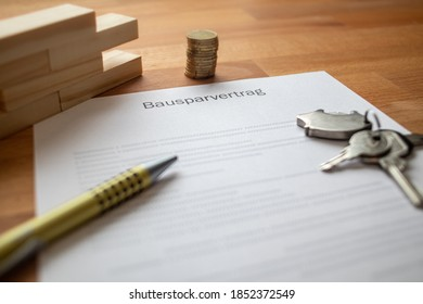 home savings contract with a key chain on a table