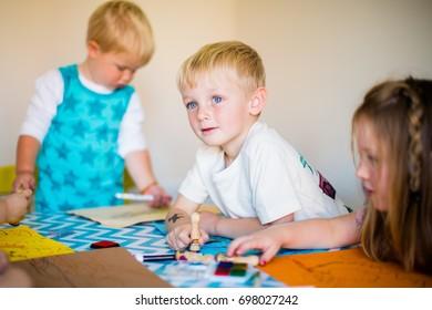 home schooling children doing artwork being creative