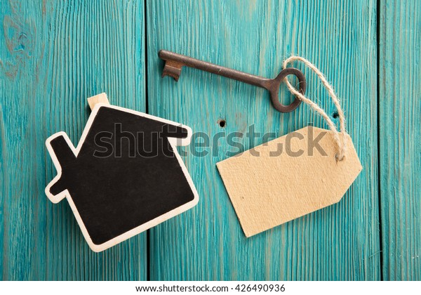 home security concept - little house and old key