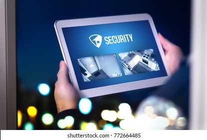 Home security system and application in tablet. Man watching protection camera live footage inside a house or apartment late at night. Imaginary smart app.