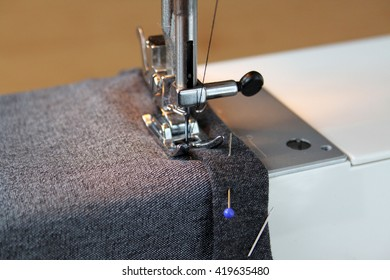 Home sewing machine in shortening pants