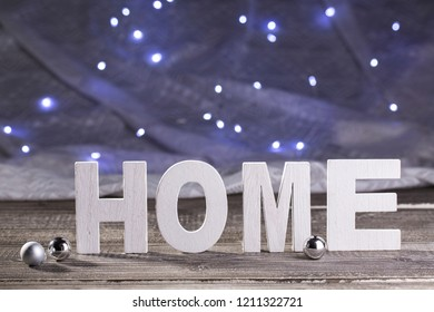 """HOME"" subtitle with silver balls for decoration"