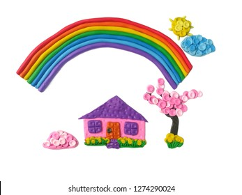 Home sweet home and beautiful sky made from colorful plasticine clay on white background, sun cloud tree flower and cute house are view dough