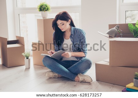 6c8f17ee6 Home, sweet home! Young girl in casual clothes sitting with crossed legs on  the