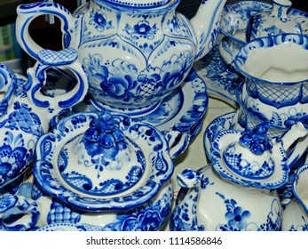 Home tableware in Russian traditional Gzhel style. Closeup. Gzhel - Russian folk craft of ceramics and production porcelain and a kind of Russian folk painting. Low DOF.