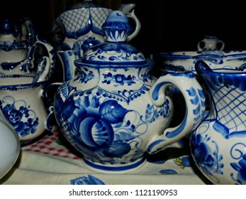 Home tableware in Russian traditional Gzhel style. Closeup. Gzhel - Russian folk craft of ceramics and production porcelain and a kind of Russian folk painting. Selective focus
