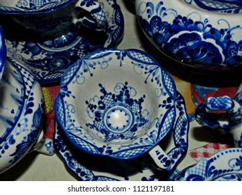 Home tableware in Russian traditional Gzhel style. Closeup. Gzhel - Russian folk craft of ceramics and production porcelain and a kind of Russian folk painting. Selective focus.