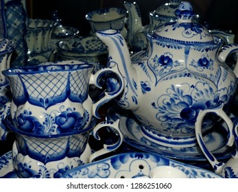 Home tableware in Russian traditional Gzhel style. Closeup. Gzhel - Russian folk craft of ceramics and production porcelain and a kind of Russian folk painting.