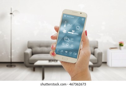 Home temperature, safety and environment control on mobile app. Smart phone in woman hand. Living room in background.