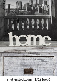 Home text on white wooden cabinet
