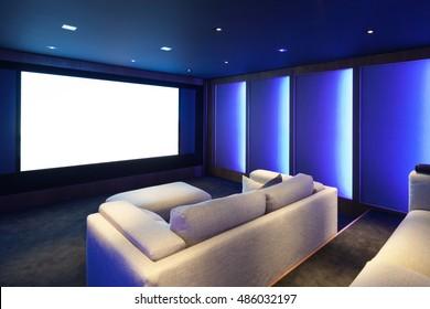 Home theater, luxury interior, comfortable divan and big screen