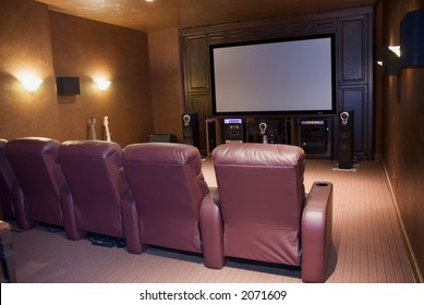 home theater room with four seats