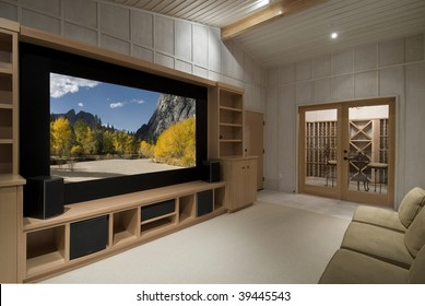 home theater with wine tasting room, big screen, wood cabinets,photo on screen is one of my shots from yosemite