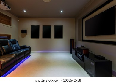 Home thetre room with projector and leather lounges
