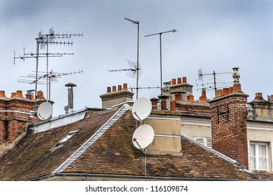 Home TV antennas mounted on a roof.