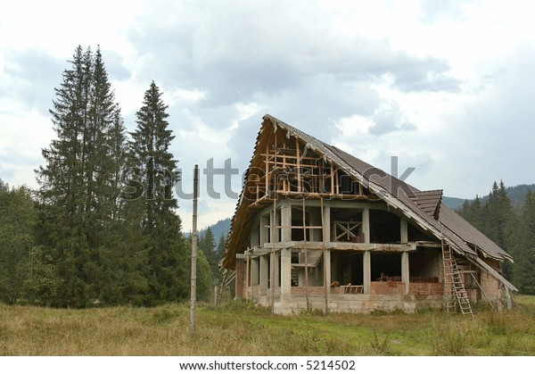 home under construction at the mountain side