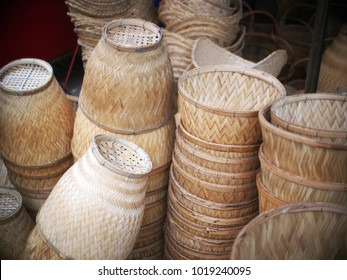 home use utensils made of woven bamboos as useful local products and souvenir from hand craft for sale selective focus authentic photo on a street market in THAILAND