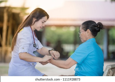 home visit by young nurse to elder women,community service of Thailand public health