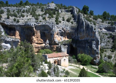 Home of vultures, Canyon of the Wolves River, Soria, Spain, with church San Bartolomé, romanesque
