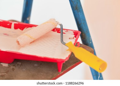 Home wall improvement beige painting by roller worker