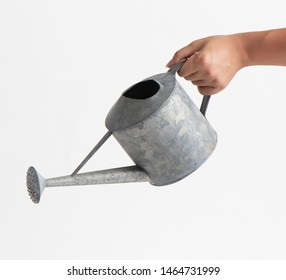 home watering can pouring over white background