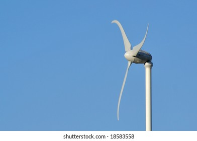 Home wind turbine with negative space at left.