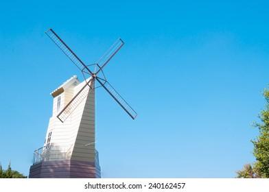 Home wind turbines in season flowers.