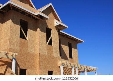 Home wooden framework with plywood and boards of a new home development