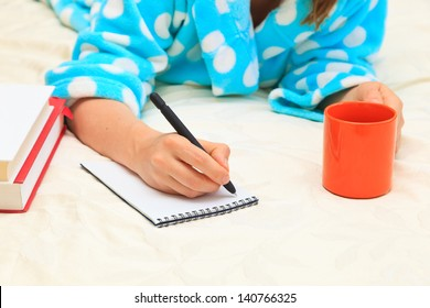 Home work. Woman with cup of coffee working from home