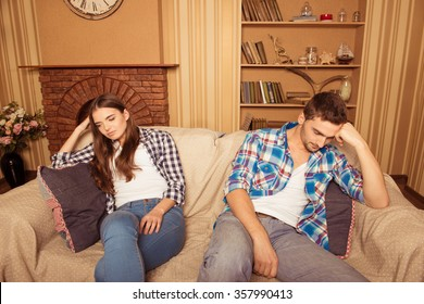 at home a young couple sitting on the couch at loggerheads