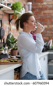 Home. Young woman in kitchen