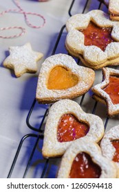 Homebaked Christmas Cookies With fruit Jam filling and Icing Sugar.