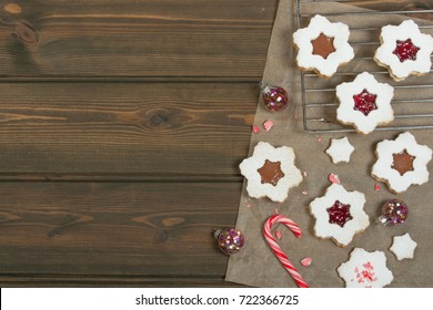 Homebaked Christmas Star Cookies With Chocolate, Cherry Jam, Icing Sugar