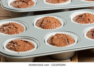 Homebaked Muffins With Chocolate, Banana, Coconut In Baking Tray