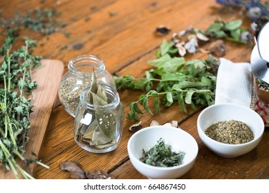 Homegrown fresh and dry herbs composition on rustic table