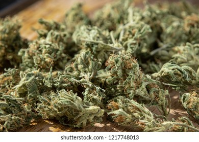 Homegrown Marijuana Buds. Cannabis Flowers on Wood Table Background with Copy Space.