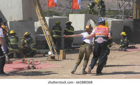 Homeland Security Soldiers, firefighters and MDA paramedics rescuing injured people from earthquake rocket attack tsunami during Operation Turning Point 17 drill. Karmiel Israel, June 14th, 2017