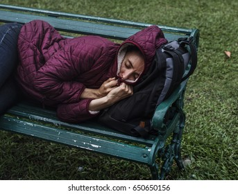 Homeless Adult Woman Sleeping on Bench in The Park