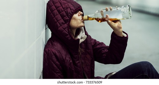 Homeless Alcoholism Woman Drinking Alcohol Sitting on The Floor